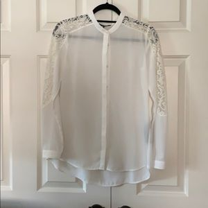 White blouse with lace.